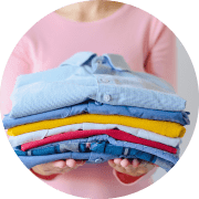 circle-1-holding-folded-shirts